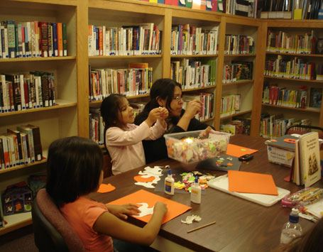 Chlidren and adult making crafts in the library
